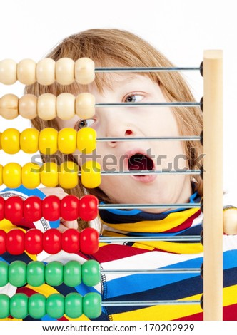 Boy Counting on Colorful Wooden Abacus Yawning - Isolated on White - stock photo