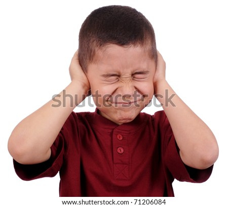 boy covering ears from loud noise, eight years old, isolated on pure white background - stock photo