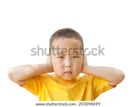 boy covers his ears with his hands, isolated on white background - stock photo