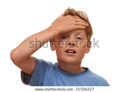 Boy covers his forehead with his hand - stock photo