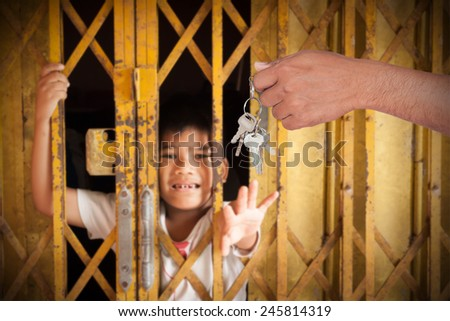 boy cry lone and hand hold cage behind door with sad because someone lock with key  - stock photo