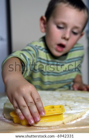 boy cutting out cookies - stock photo