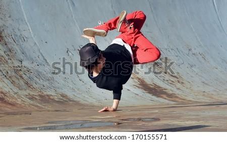 Boy dancing breakdance on the street - stock photo