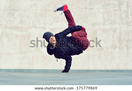 Boy dancing on the street - stock photo