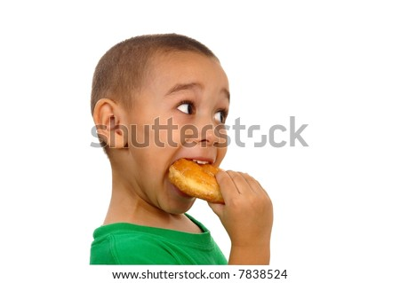 Boy devouring a donut - stock photo
