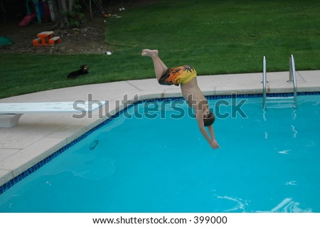 boy diving into pool - stock photo