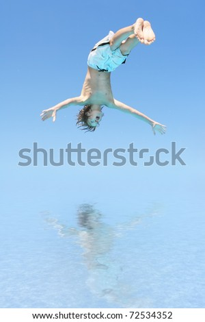 Boy diving into the water - stock photo