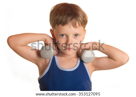 Boy does physical exercises with dumbbells bending and extending both hands
