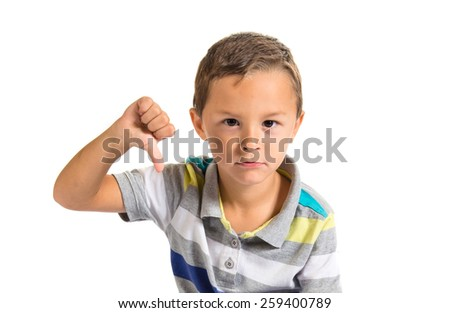 Boy doing a bad signal over white background - stock photo