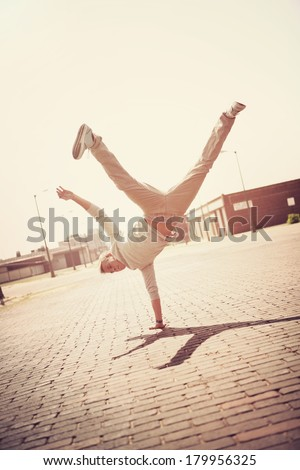 Boy doing a handstand  - stock photo