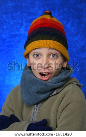 Boy doing fun expression  in winter outfit. Look at my gallery for more winter images