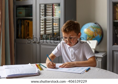 Boy doing his homework and studying
