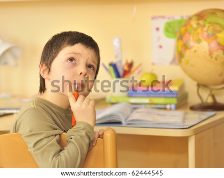 boy doing homework - stock photo