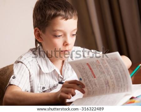 Boy doing homework. Child education - stock photo