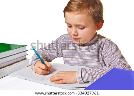 Boy doing homework, isolated on white background - stock photo