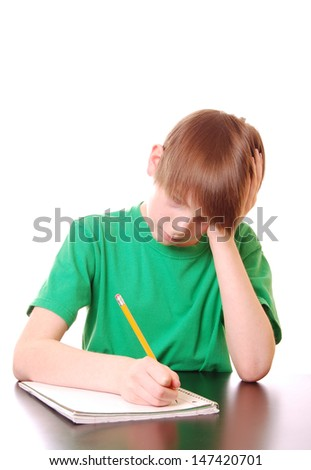 Boy doing homework (isolated with copy space, and green clothing for easy color replacement) - stock photo