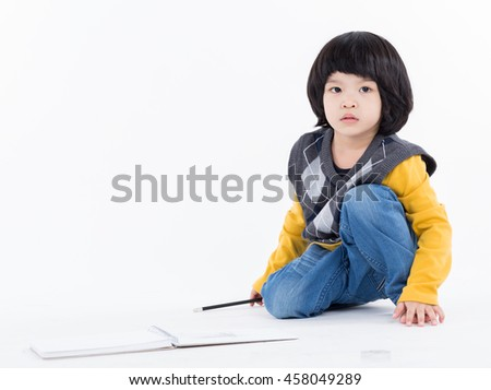 Boy doing homework with pencil on white background
