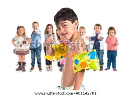 Boy doing swimming gesture - stock photo