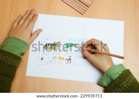 Boy drawing on the paper - stock photo