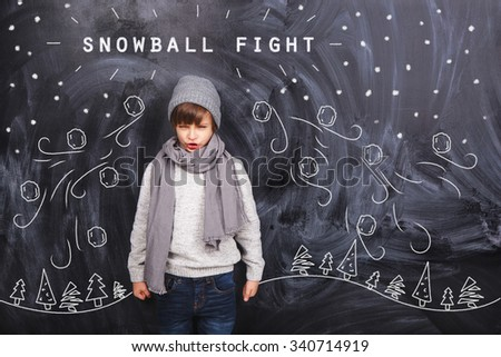 Boy dreams of a snowball fight - stock photo