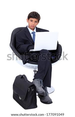 Boy dressed as a businessman - stock photo