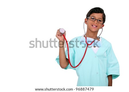 Boy dressed as a doctor - stock photo