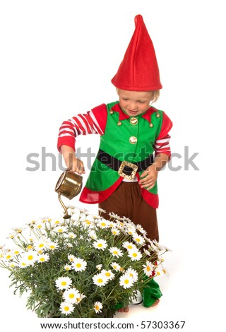 Boy dressed as a garden gnome with a watering can - stock photo