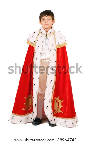 Boy dressed as a king. Isolated on white