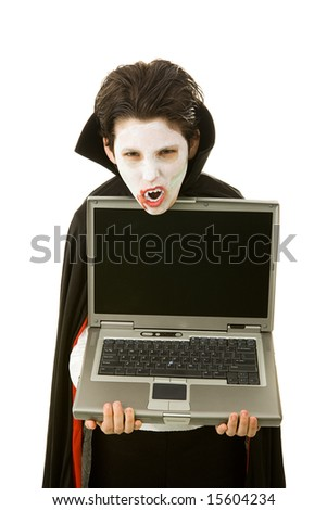 Boy dressed as a vampire for Halloween, holding a computer with a message on it.  Blank space ready for your text.  Isolated on white. - stock photo