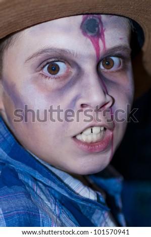 Boy dressed as zombie head shot - stock photo
