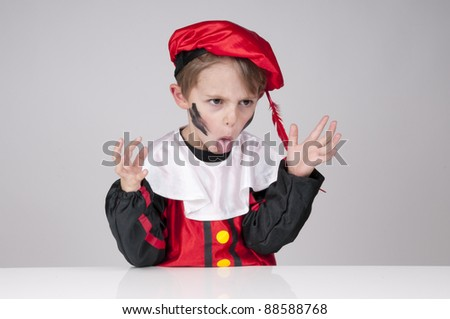 boy dressed up as Black Peter pulling his tongue out