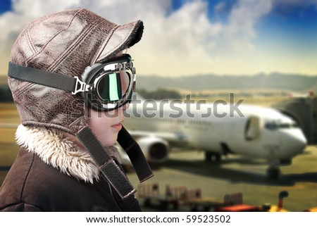 Boy dressed up in pilot?s outfit, jacket, hat and glasses. - stock photo