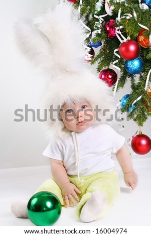Boy dressed with a white downy bunny costume.