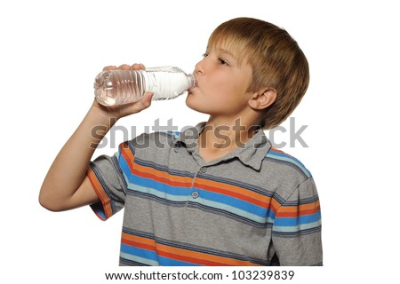 Boy Drinking Bottle of Water. Young boy drinking a bottle of water on white. - stock photo