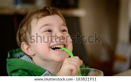 Boy drinking juice - stock photo