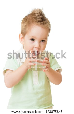 Boy drinking water from glass isolated on white - stock photo