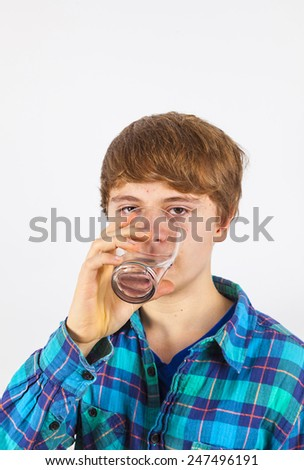 boy drinking water out of a glass - stock photo