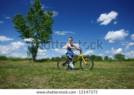 Boy driving  a bike in the park