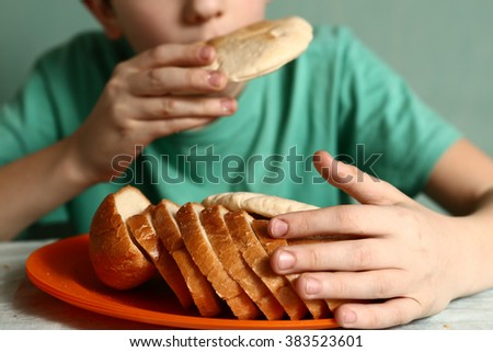boy eat tortilla bread  closeup portrait on blue background