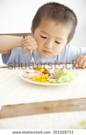 Boy eating breakfast