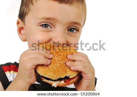Boy eating burger - stock photo