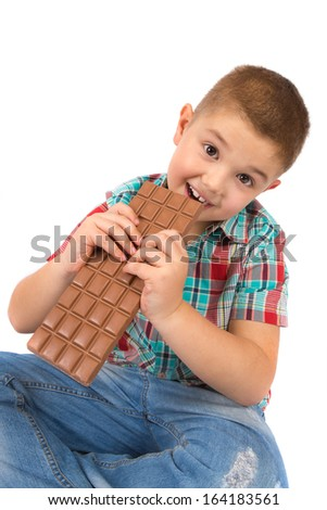 Boy eating chocolate - stock photo