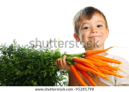 Boy eating fresh carrots isolated on white background - stock photo