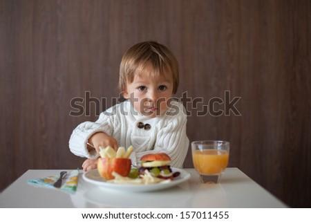 Boy, eating fruit sandwich - stock photo