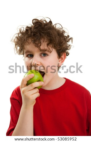 Boy eating green apple isolated on white background