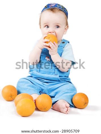 Boy eating orange - stock photo