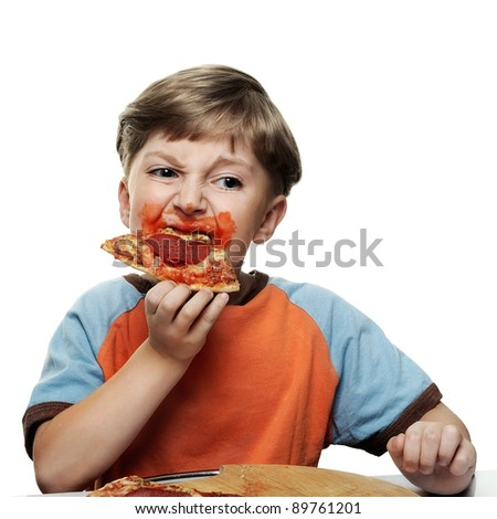 Boy Eating Pizza - stock photo