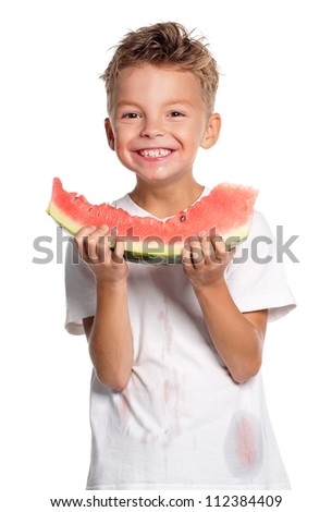 Boy eating slice of watermelon isolated on white background - stock photo