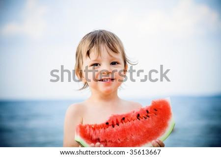 boy eating watermelon - stock photo