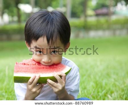 boy eating watermelon - stock photo